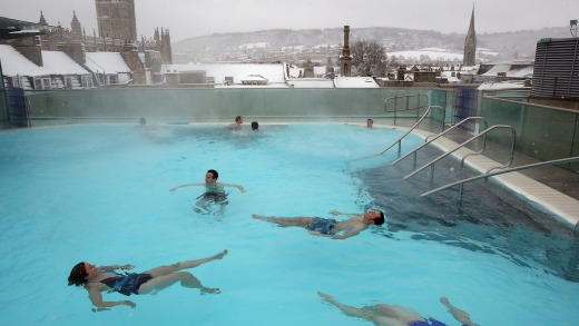 Bathers enjoy the rooftop pool at the Thermae Bath Spa.
