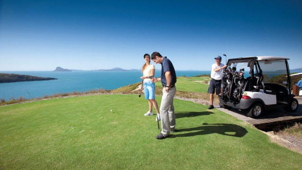 Playing a round of golf on Dent Island's impressive 18-hole championship course.