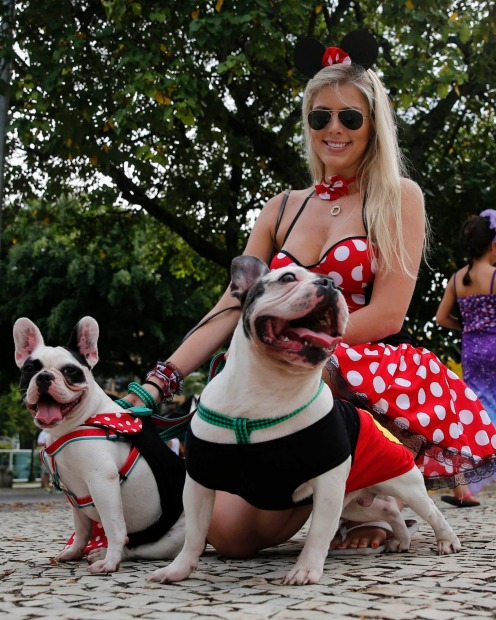 A reveller with her dogs take part in the 'Blocao' or dog carnival parade during carnival festivities in Rio de Janeiro.