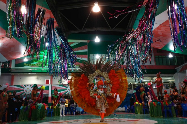 A participant attends a carnival luxurious costume contest during the Glam Gay pre-carnival Ball, in Mangueira samba ...