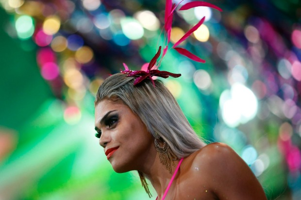 A participant attends a beauty contest for transvestites and transsexuals at the Glam Gay pre-carnival Ball, in ...