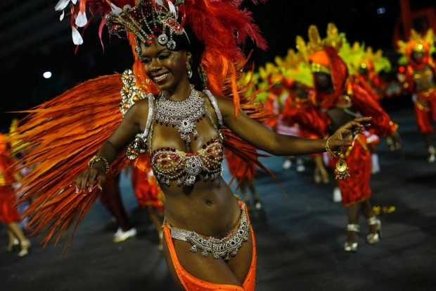 A reveller from the Unidos de Bangu samba school  takes part in the Group A category of the annual Carnival parade in ...