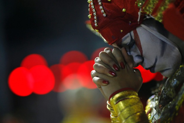 A reveller from the Unidos de Bangu samba school concentrates before taking part in the Group A category of the annual ...
