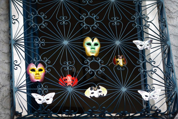 Carnival masks hang on a window of a house near an annual block party known as 'Ceu na Terra' (Heaven in Earth), one of ...