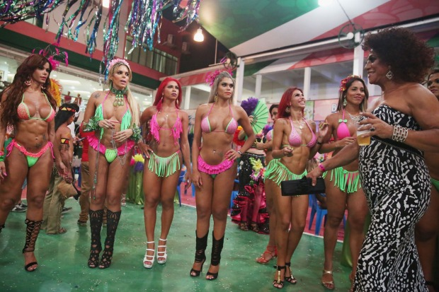 Beauty contestants stand during the Gay Glam Ball inside the Mangueira samba school.