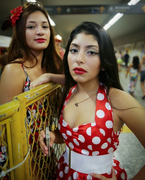 Revellers pose in a subway station during a 'bloco' street parade during pre-Carnival festivities in Rio de Janeiro, Brazil.