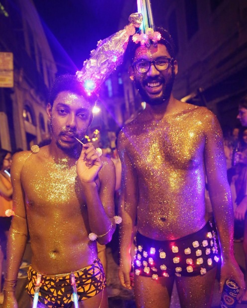 Revellers pose during the My Light is LED 'bloco' pre-Carnival street parade in Rio de Janeiro, Brazil.