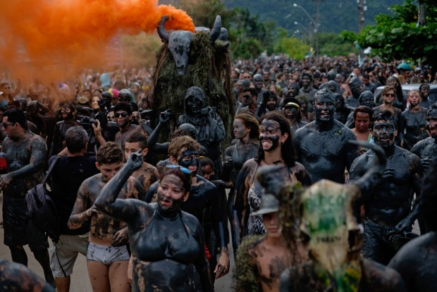 Revellers parade during 'Bloco da Lama', a mud carnival in Paraty.