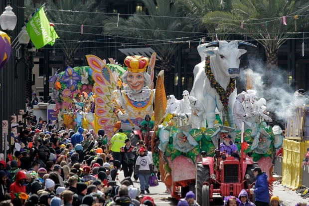 The parade rolls through on Mardi Gras, in New Orleans. The crowd was thick along St. Charles Avenue, where the route of ...