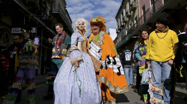 Revellers parade through the French Quarter on Mardi Gras in New Orleans, Louisiana.