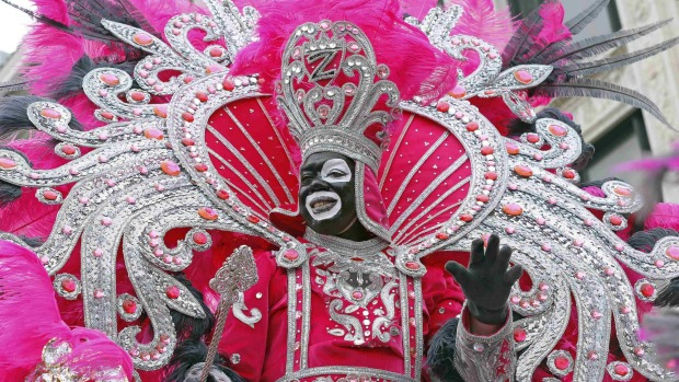 Andrew Sanchez Jr., King of Zulu, waves to crowds on Mardi Gras in New Orleans, Louisiana.