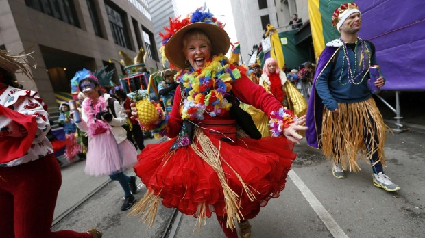 A Member of the Mondo Kayo Social and Marching Club parades down St. Charles Avenue on Mardi Gras in New Orleans, Louisiana.