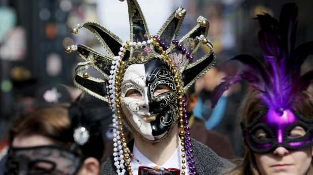 A reveller makes his way through the French Quarter on Mardi Gras in New Orleans, Louisiana.