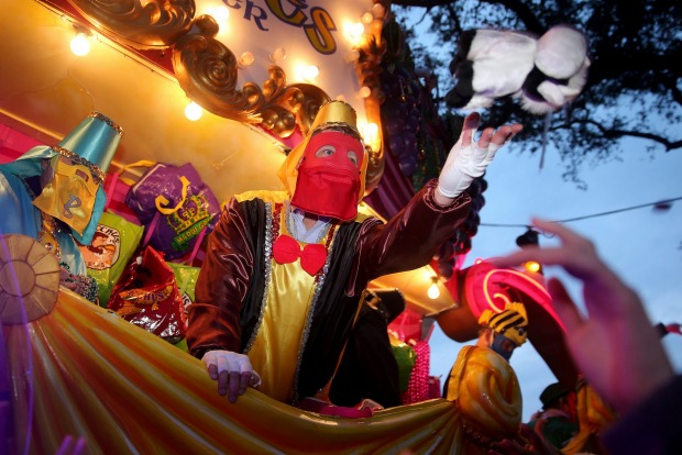 The Krewe of Bacchus, the fourth and largest of Sunday's parades in New Orleans, rolls down the traditional uptown ...