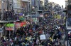 Revelers pack Bourbon Street beneath the balcony of the Royal Sonesta Hotel in New Orleans on Mardi Gras day in the ...