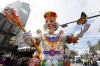 A float from of the Krewe of Rex turns onto Canal St. on Mardi Gras in New Orleans, Louisiana.
