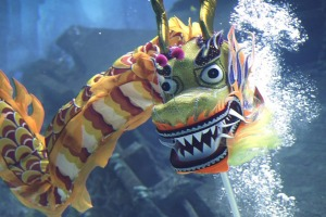 Divers perform an underwater dragon dance at the S.E.A. Aquarium.