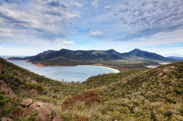 Hobart to Launceston, via Tasmania's east coast: Wineglass Bay aerial view from mountain top lookout towards Hazards ...