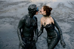 """A couple of revellers kisses before taking part in """"Bloco da Lama"""", a mud carnival in Paraty, about 250km south of Rio ..."""