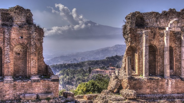 Sicily, Italy: The ancient theatre at Taormina has a stunning backdrop of Mt Etna.