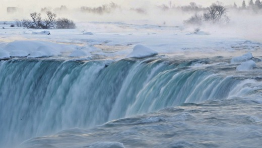 Pieces of ice flow over the Canadian 'Horseshoe' Falls in Niagara Falls.