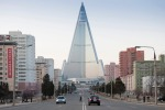 City centre of Pyongyang with skyscraper and traffic. The Ryugyong hotel was unfinished for many years. A foreign ...