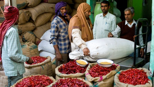Businessmen and porters at a stall selling red chillies at the Old Delhi Spice Market in Khari Baoli Road.