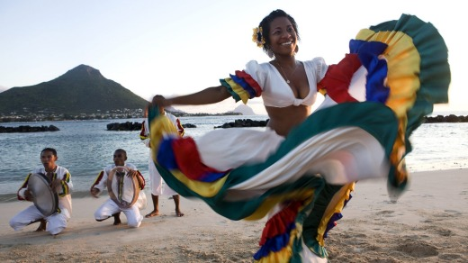 Swirling colours: A woman performs the sega, the national dance of Mauritius.