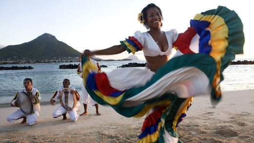 Segae dancer performs on a beach in Mauritius.