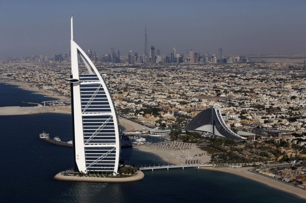 City skyscrapers stand on the skyline beyond the Burj Al Arab luxury hotel, left, and Jumeirah Beach hotel, right, in ...