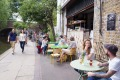 Trendy cafes and restaurants line the towpath of the Regent's Canal in Shoreditch.