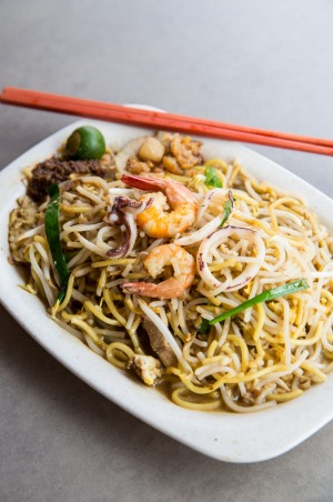 In Singapore, Hokkien mee (noodles) are fried over charcoal, giving them a smoky infusion and cooked with plenty of lard ...