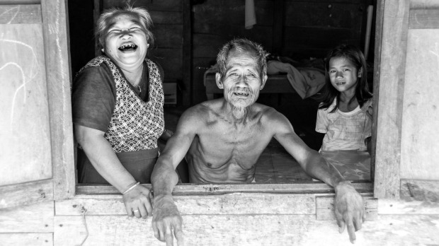 Whilst walking the streets of a small village in Nias, Indonesia I came across this family sitting in the window of ...