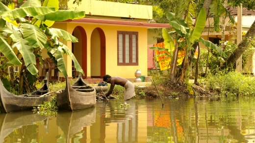 Colourful, boxy houses typical of the Kerala backwaters .