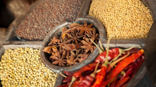 Spices for sale in Cochin, Kerala, presented in a traditional timber spice wheel.