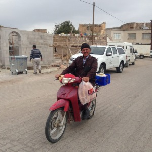 A local on a motorbike.
