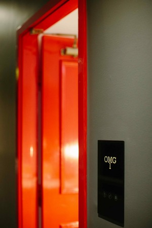 The striking red entrance to the Penthouse.
