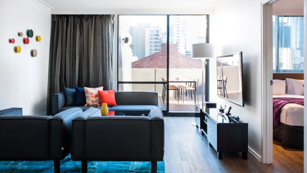 A Terrace Suite and the view of Melbourne CBD from the window.