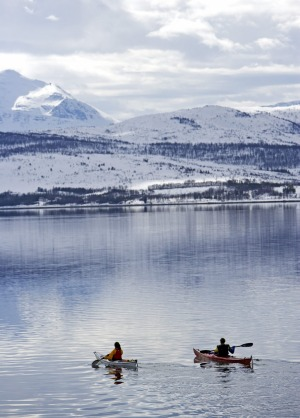 Kayaking on the crystal-clear water in Tromso, Norway.