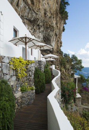 The  Eudesea suites are cut into the rock face  down by the beach.