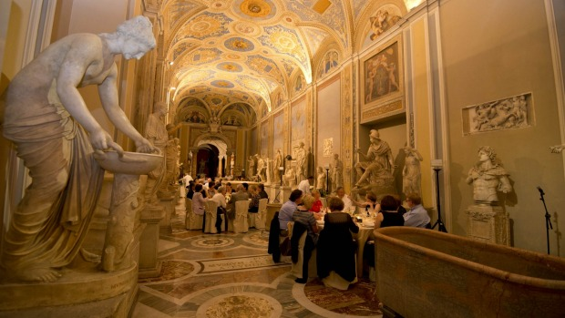 Visitors are seated for dinner in the Vatican.
