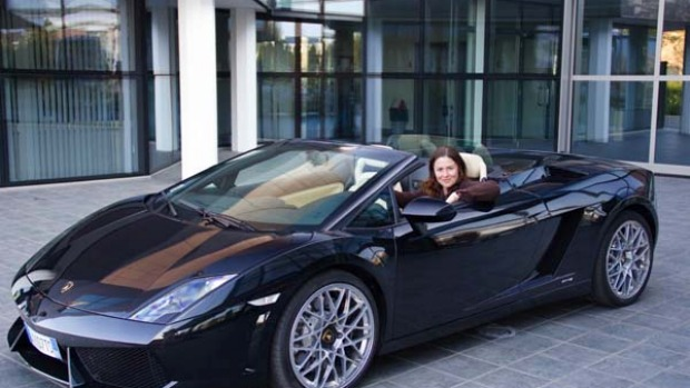 Flying start ... the writer in a convertible Lamborghini.