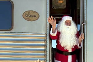 Cross our heart ... (from left) dining in the restaurant car; winding through the outback; Santa's a hit with children ...
