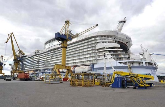 Allure of the Seas is 360 metres long, weighs 225,000 gross tonnes and can carry 8565 passengers and crew on 16 decks ...
