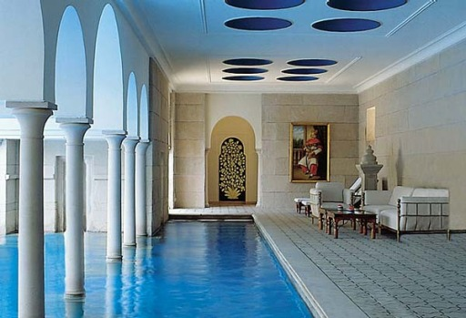 Terraced gardens and pavilions overlook the swimming pool which has a cool, peaceful recess in which to escape the ...