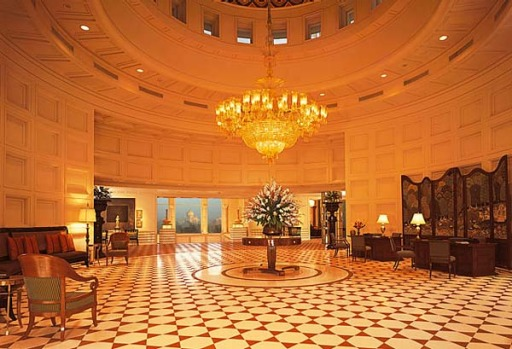 In the vast lobby, a crystal chandelier hangs from an Islamic style dome coloured in cobalt-blue pigment and gold.