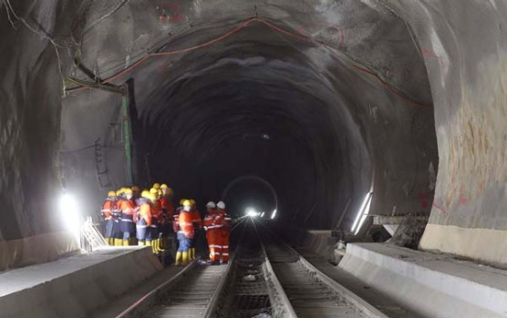 Visitors stand at the construction site of the NEAT Gotthard Base Tunnel at the Erstfeld-Amsteg section.