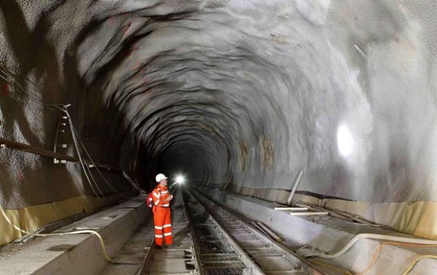 THE LONGEST RAILWAY TUNNEL IN THE WORLD: A worker stands at the construction site of the NEAT Gotthard Base Tunnel.