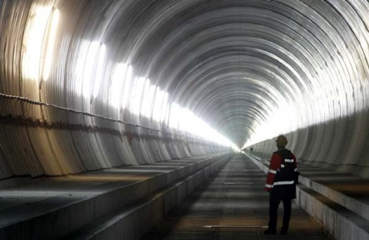 A giant drilling machine will complete the world's longest tunnel beneath the Swiss Alps today, paving the way for ...