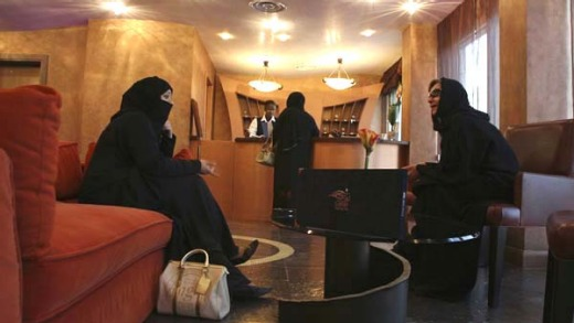 Saudi women rest in the lobby of the Luthan Hotel, which caters exclusively to women.